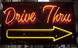 Kör till och med neon undertecknar Arkivbild