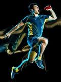 Körande jogger för löpare som joggar man isolerat ljus som målar svart bakgrund arkivbilder