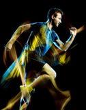 Körande jogger för löpare som joggar man isolerat ljus som målar svart bakgrund arkivbild