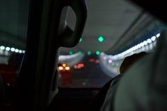 Körning av bilen på natten till och med en tunnel royaltyfria foton