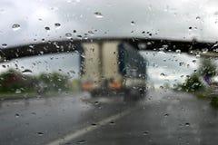körning av iv-regn Arkivbild