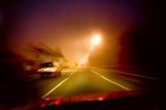 körning av natt Arkivbild