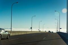 Körning in i molnen Arkivfoto