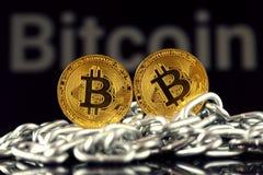 Körperliche Version der neuen virtuellen Geldes und Kette Bitcoin Lizenzfreie Stockfotos