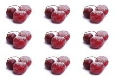 Körsbär som frysas i is Arkivbilder