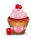 Körsbärsröd muffin Arkivbild