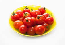 Körsbärsröda tomater med svansar Arkivfoton