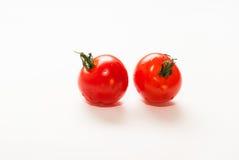 Körsbärsröda tomater med svansar Royaltyfria Bilder