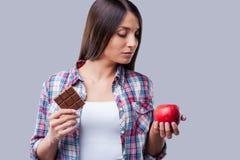 Köstlich und schädlich oder hilfreich und geschmackvoll? lizenzfreie stockfotos