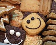 Köstliche lächelnde Plätzchen - Hintergrund Stockfotos