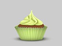 Köstlicher kleiner Kuchen mit grüner Creme Stockfotografie