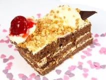 Köstlicher Kuchen auf weißem Hintergrund Lizenzfreie Stockfotos