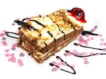 Köstlicher Kuchen auf weißem Hintergrund Stockbild