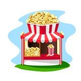 Köstlicher und heller Popcornshop mit einem Papierglas Popcorn auf dem Dach Stockbilder