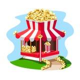 Köstlicher und heller Popcornshop mit einem Papierglas Popcorn auf dem Dach Lizenzfreie Stockfotos
