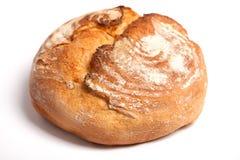 Köstliches frisches Brot auf einem weißen Hintergrund Lizenzfreie Stockfotografie