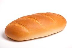 Köstliches frisches Brot auf einem weißen Hintergrund Lizenzfreies Stockbild