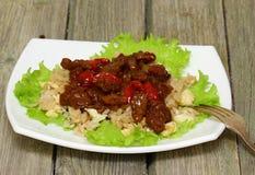 Kött med grönsaker och ris Arkivfoton
