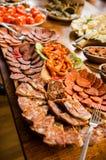 Kött och aptitretareuppläggningsfat Arkivfoton