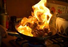 Köttbullar på brand Arkivfoto