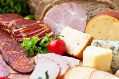Köttprodukter och ost fotografering för bildbyråer