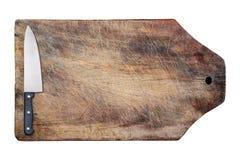 Küchemesser auf der hölzernen Tabelle, getrennt. Lizenzfreie Stockfotografie