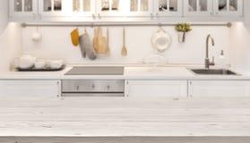 Küchentischspitze und Unschärfehintergrund des Kochens des Zoneninnenraums