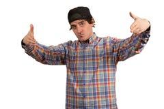 Kühler junger Kerl mit Kappe Stockfotos