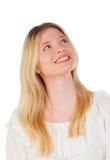 Kühles blondes Mädchendenken Stockfoto