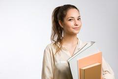 Kühles stilvolles junges Studentenmädchen. Stockfotos