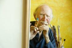 Künstler an einem Segeltuch Lizenzfreie Stockbilder