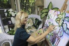 Künstler in ihrem Jahrmalen Lizenzfreies Stockfoto