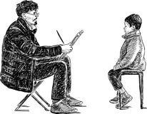 Künstler zeichnet ein Jungenporträt Stockfotos