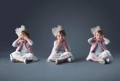 Künstlerische Konzeptcollage des netten kleinen Mädchens lizenzfreie stockbilder
