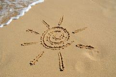 Künstlerische Sonne auf dem Strand Lizenzfreies Stockfoto