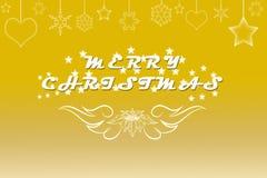 Künstlerischer Text der frohen Weihnachten geschrieben auf Gold Lizenzfreie Stockfotografie