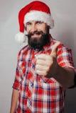 Künstlerisches Porträt von grauem behaartem Weihnachtsmann Stockfotos