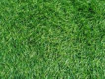 Künstlicher grüner fullframe Grashintergrund stockbild