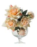 Künstlicher Roseblumenstrauß in einem Glas Stockbilder