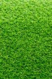 Künstliches grünes Gras für Hintergrund stockbild
