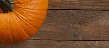Kürbis auf Holztisch Stockfotografie