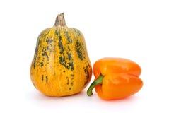 Kürbis und orange grüner Pfeffer Lizenzfreie Stockfotos