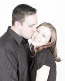 Küssen der Backe Stockfoto