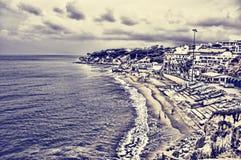 Küste und Dorf Stockbilder
