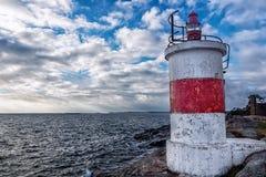 Küstenlandschaft mit Leuchtturm Stockfotografie