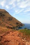 Küstenlinie des roten Lehms Lizenzfreie Stockfotos