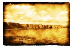 Küstenlinie von Schottland - Foto auf gebranntem Papier Lizenzfreies Stockfoto