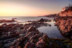 Küstenmagie mit seidigem macht Wellen glatt Stockfotos