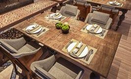 Kąta widok stołowy ustawianie dla nowożytnej Arabskiej restauracji, pojęcie, drewniany zakłopotany stół, 3d odpłaca się obrazy stock