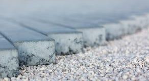 Kłaść brukowego kamienia drogowej tekstury miękką ostrość fotografia royalty free
